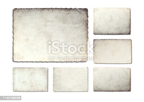 882302538istockphoto Old photo paper texture isolated on white background. 1140186598
