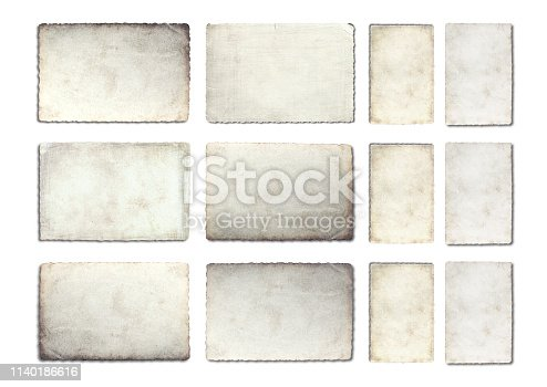 882302538istockphoto Old photo paper texture isolated on white background. 1140186616