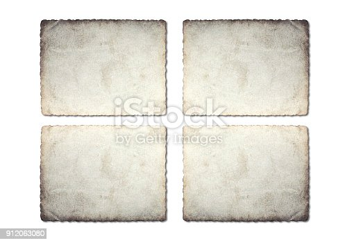 istock Old photo paper texture isolated on white background. 912063080