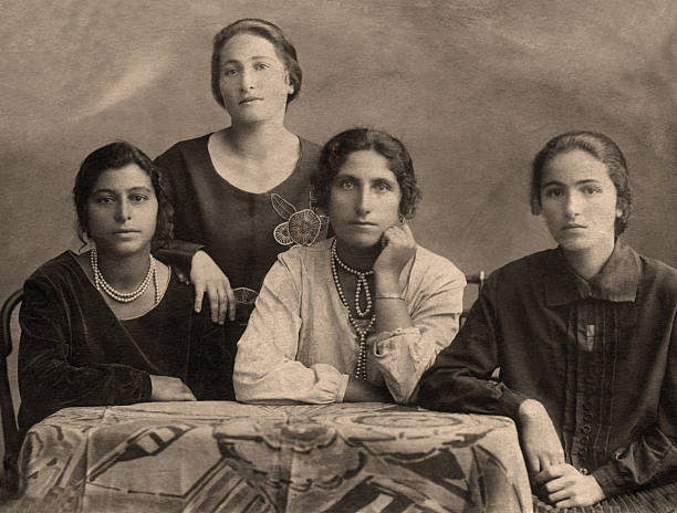 Old photo A vintage photo portrait from 1914 of Gypsy family. romani people stock pictures, royalty-free photos & images