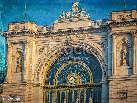 Old photo with exterior of Budapest Keleti railway station-Budapest Keleti palyaudvar. Vintage processing.