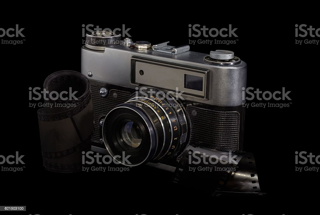 Old photographic camera and photographic films on a dark backgro Lizenzfreies stock-foto