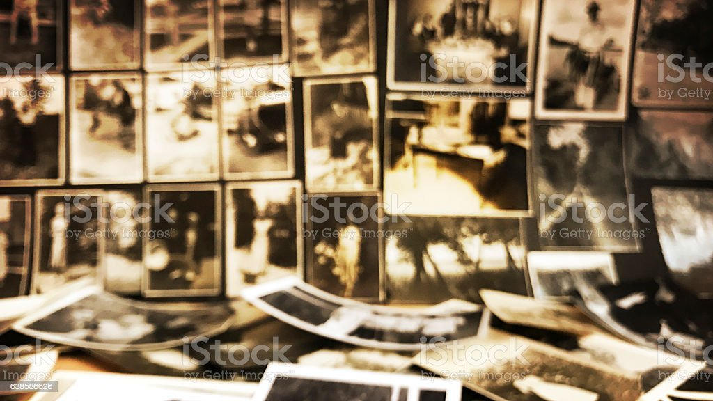 Old Photos in Piles and on Pages Defocused stock photo