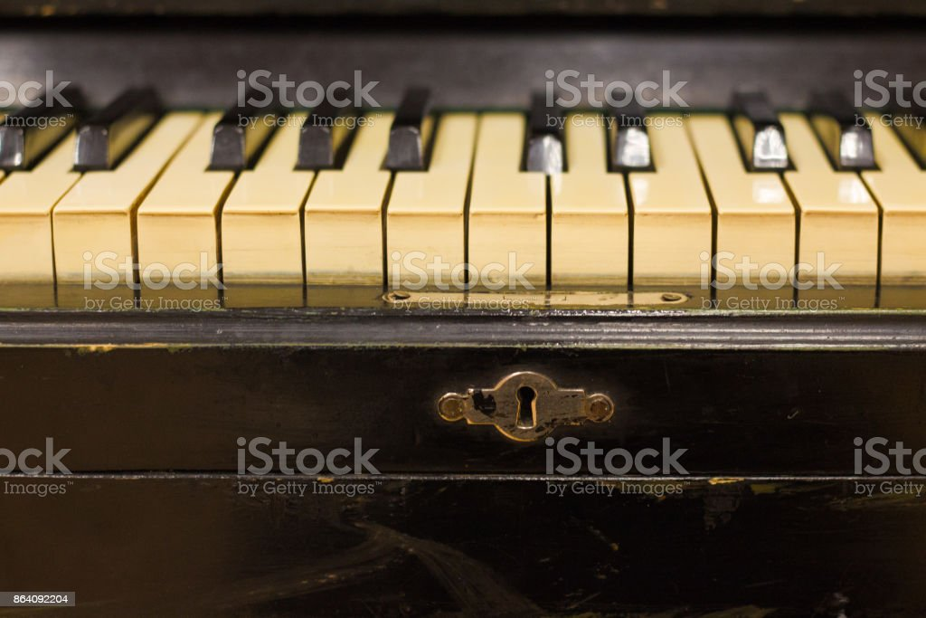 Old piano with faded keys . royalty-free stock photo