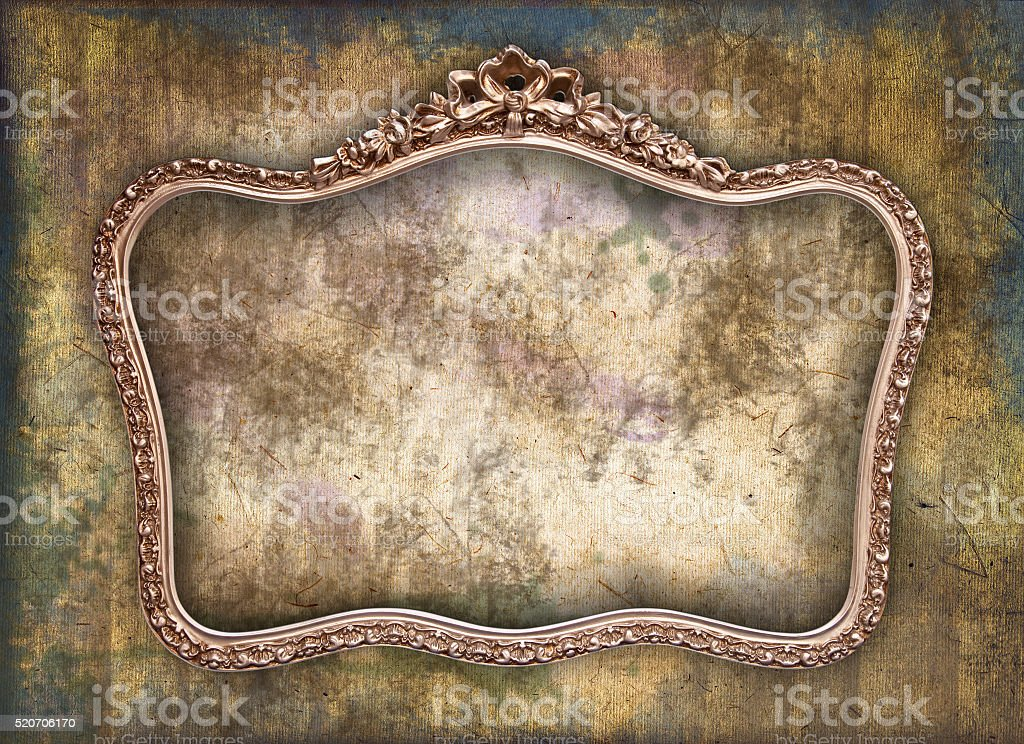 Old picture frame a a grunge wall stock photo