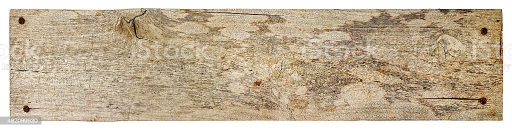 Old piece of weathered wood board. stock photo