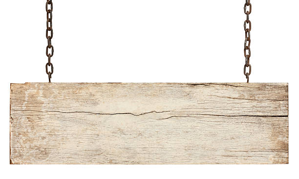Old piece of white weathered wood signboard. Old piece of white weathered wood signboard hanging by rusty chains, isolated on white,clipping path included. driftwood stock pictures, royalty-free photos & images