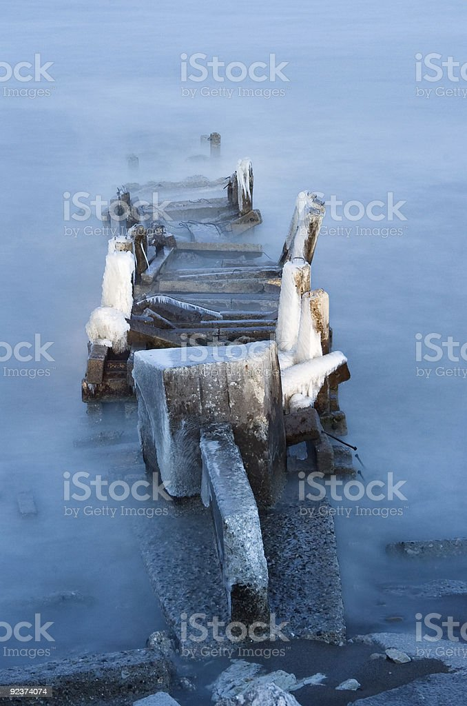 Old pier on a Winter evening royalty-free stock photo