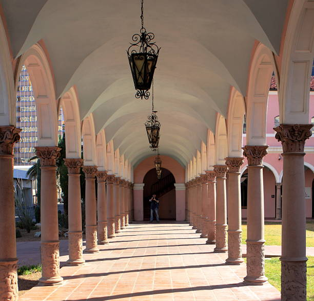 Old Pima County Courthouse in Tucson, Arizona Tucson, Arizona - February 19, 2012: Archway of the Old Pima County Courthouse in Tucson, Arizona, a tourist is taking pictures. pima county stock pictures, royalty-free photos & images