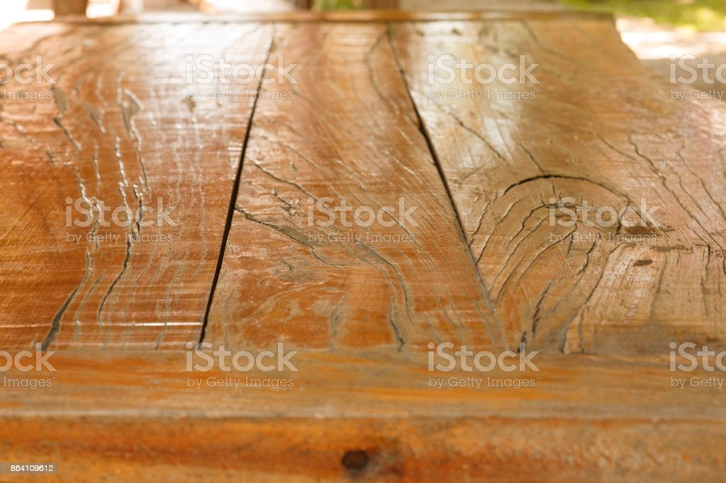 Old pine picnic table, natural  woodgrain texture. Ideal to position products on and place in the foreground of any image.  Selective focus. Very shallow depth of field for soft background. royalty-free stock photo