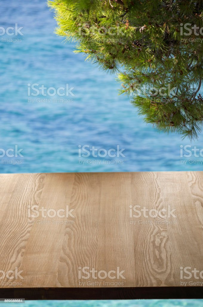 Old pine picnic table, natural woodgrain texture. Ideal to position...