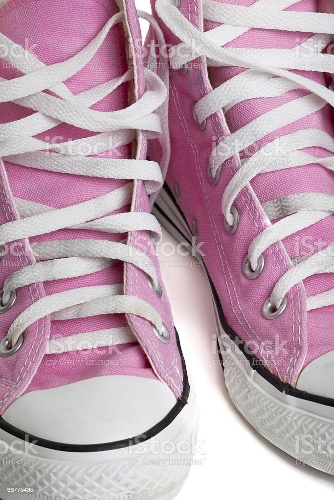 Old pink coloured basketball shoes royalty-free stock photo