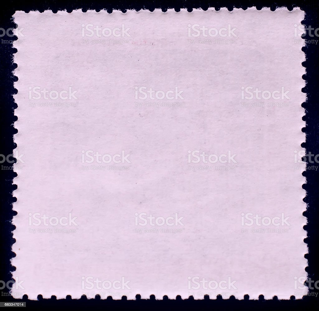 Old pink square grunge posted stamp reverse side stock photo