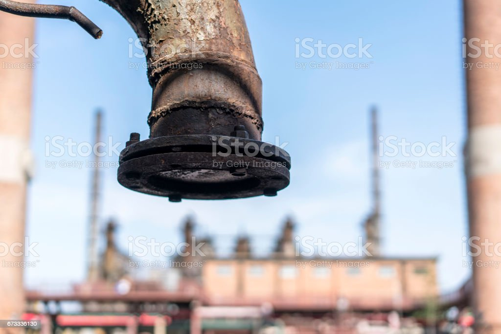 old pipe and chimney in an abandoned factory stock photo