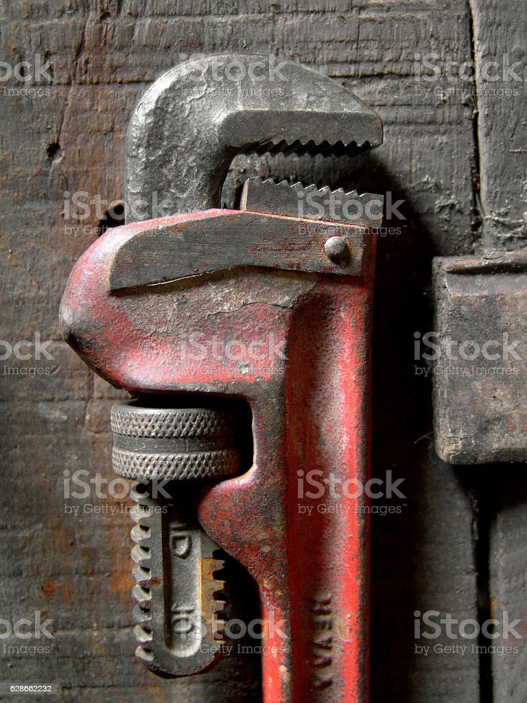 Old pipe wrench stock photo