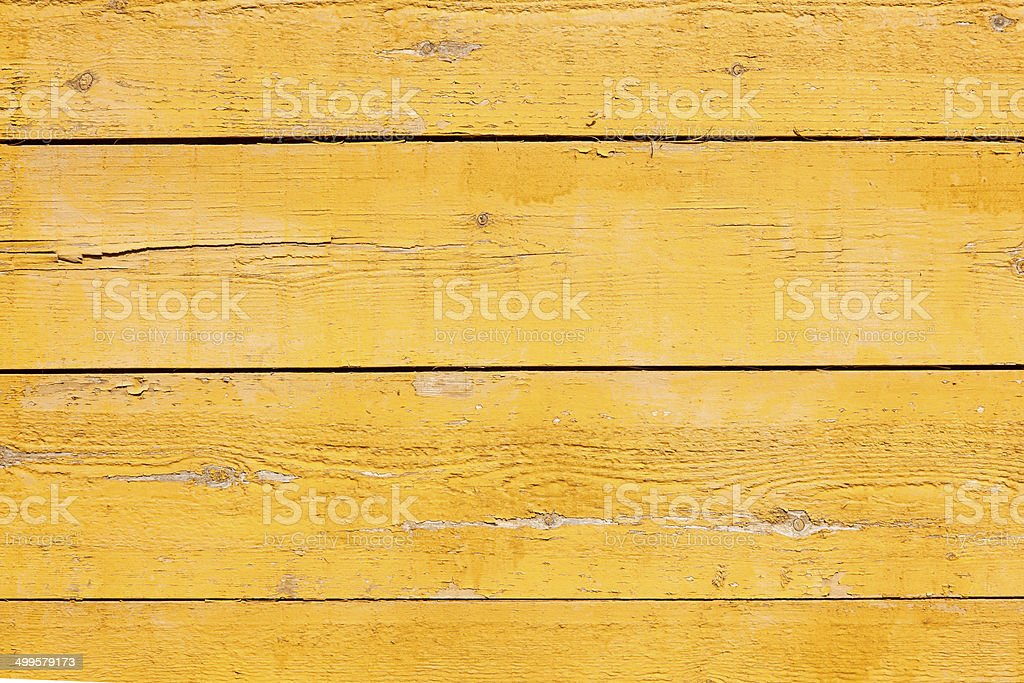 old planks with bright yellow paint stock photo