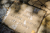Aix En Provence: metal cobble stone in the pedestrian zone in Aix to mark the way Cezanne was going.