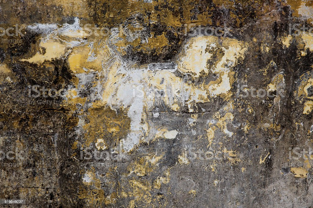 Old plastered surface of yellow and gray stock photo