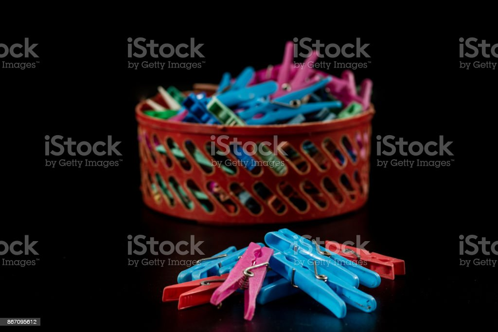 Old plastic buckles on a black countertop. Clipped very worn on a black background. Hanging laundry and laundry. stock photo