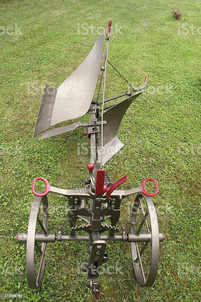 Old plough on wheels royalty-free stock photo