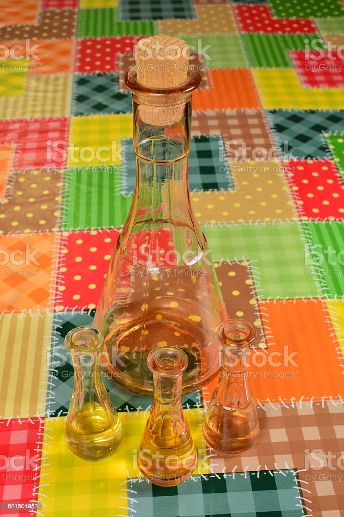 Old plum schnspps in the bottle and three shot glasses photo libre de droits