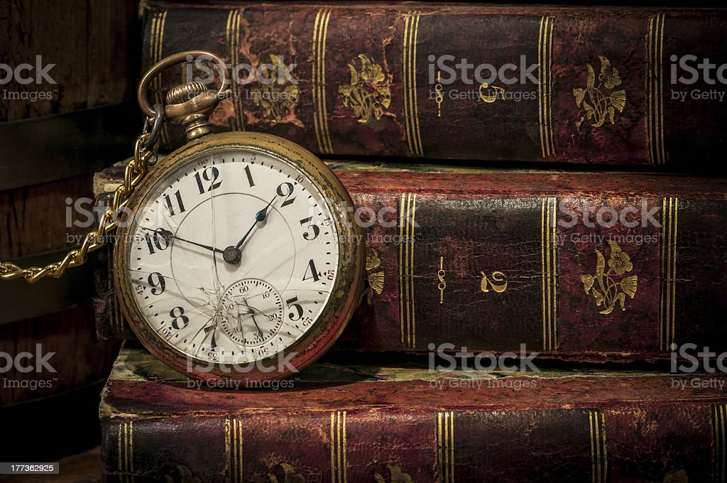 Old pocket watch and books in Low-key copy space stock photo