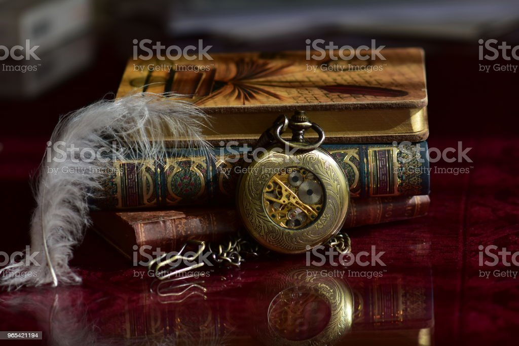 Old pocket watch and books royalty-free stock photo