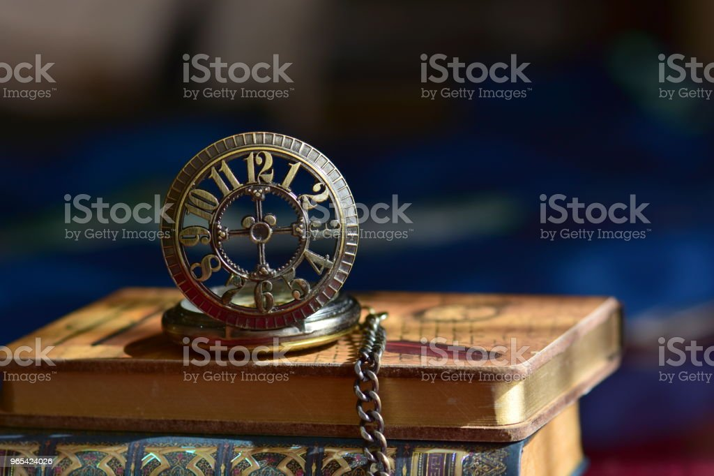 Old pocket watch and books zbiór zdjęć royalty-free