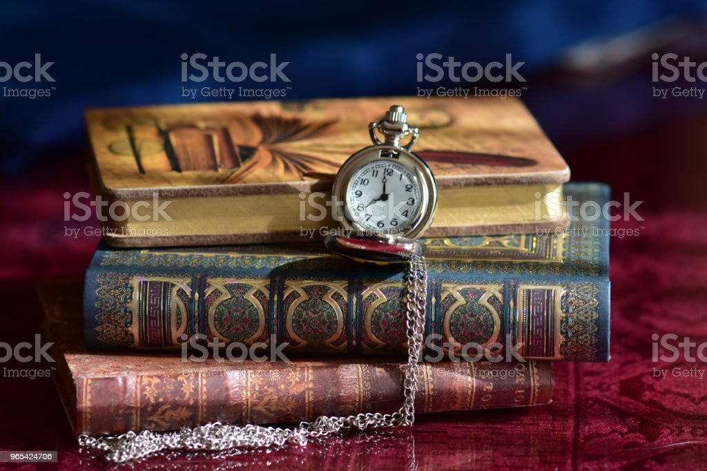 Old pocket watch and books zbiór zdjęć royalty-free