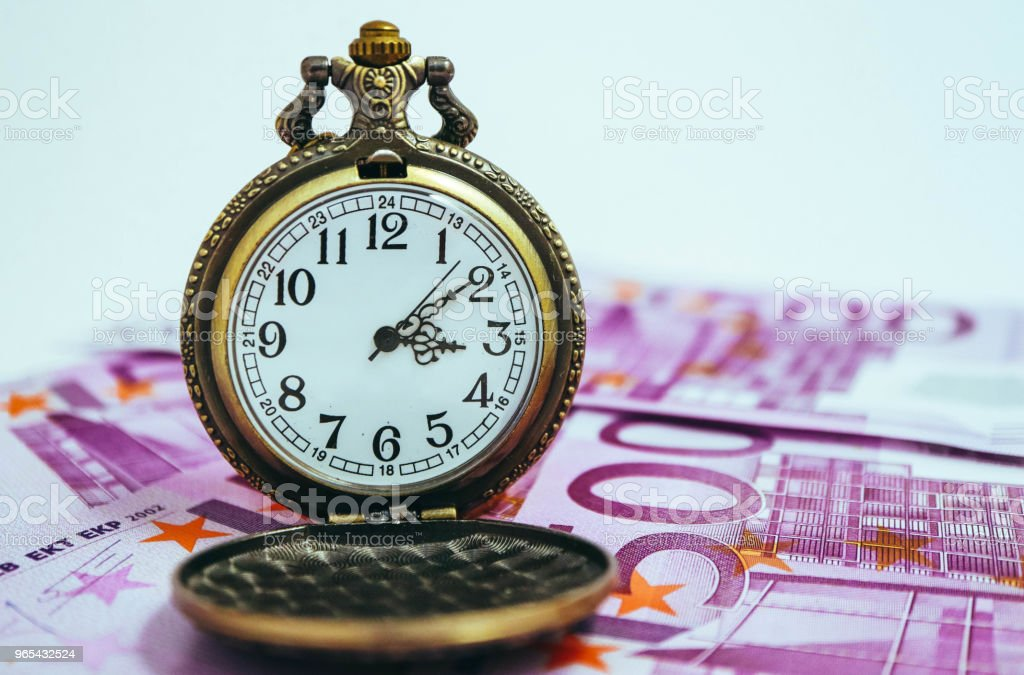 Old pocket watch with euro banknotes money, macro view. Time and business concept. zbiór zdjęć royalty-free