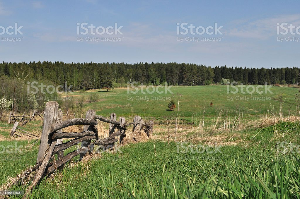 Old pole fence in village royalty-free stock photo