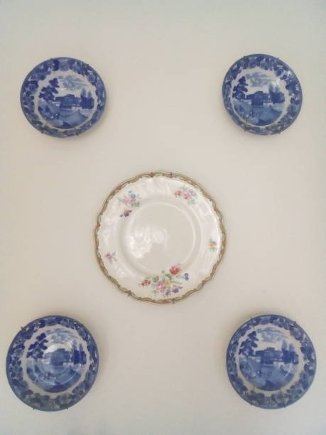 old porcelain on white background stock photo