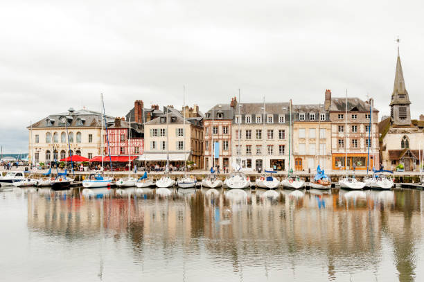 Old port and harbour of Honfleur City hall (Hotel de Ville on the left), restaurants and shops at picturesque old port and harbour of Honfleur in Normandy region of France calvados stock pictures, royalty-free photos & images