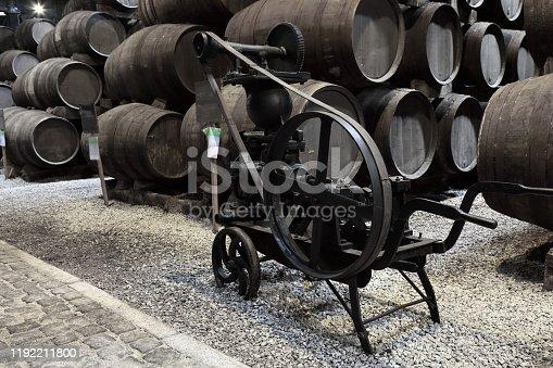 Old Porto wine cellar with wooden barrels in Porto, Portugal