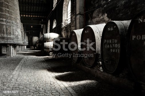 Old Porto wine cellar with wooden barrels in Porto, Portugal