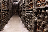 Dusty bottles of wine in old wine cellar in Porto, Portugal