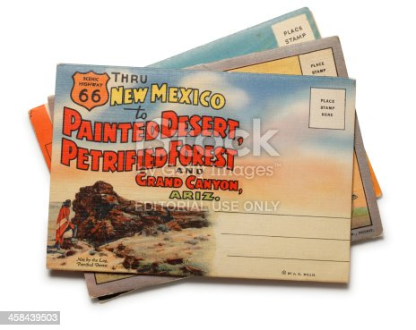 San Diego, California, USA - November 3, 2010: A stack of postcards depicting Arizona\'s Painted Desert, Petrified Forest and the Grand Canyon along old and historic Route 66.  Post card was published by J.R. Willis. Shot in a studio setting on a white background.