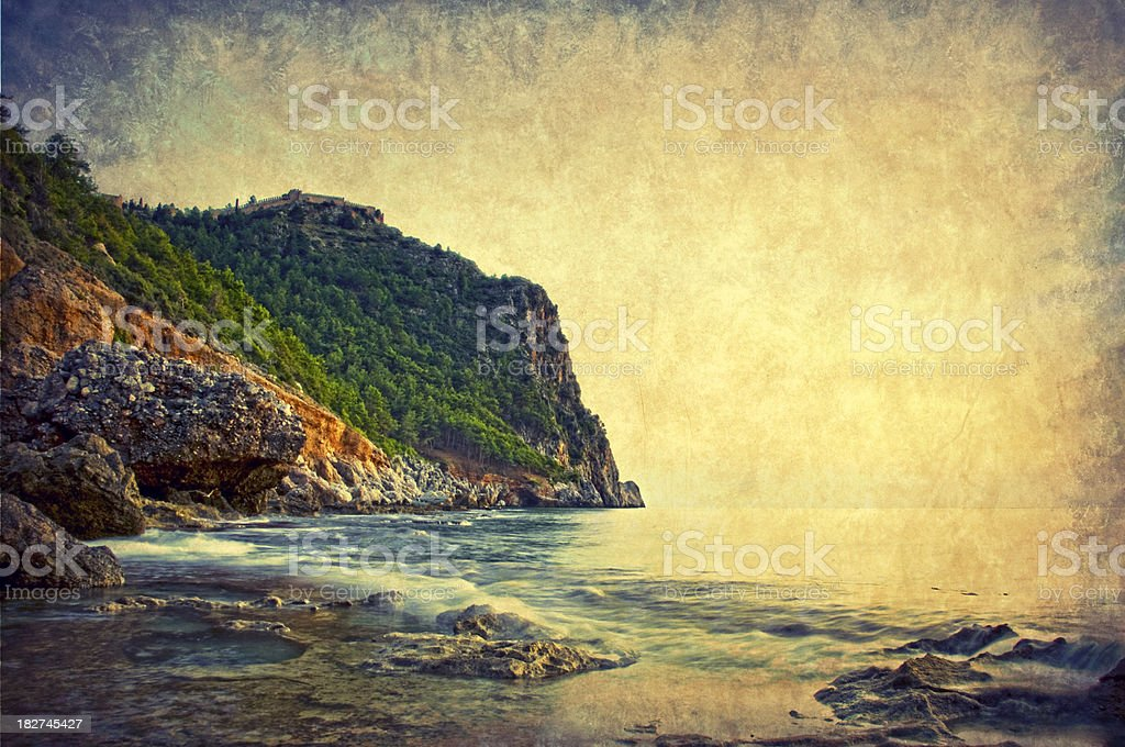 Old postcard, rocky coastline royalty-free stock photo