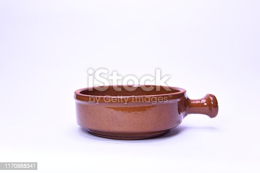 Old Pottery pan - kitchen retro equipment of cooking isolated on white background.