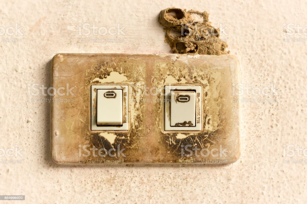 Old power switch on old wall. stock photo