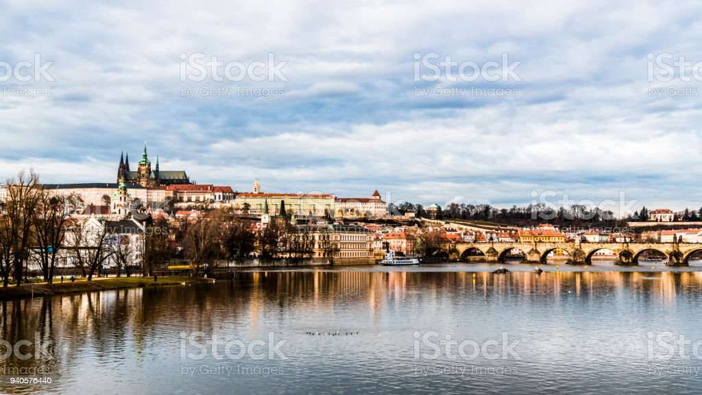 Old Prague is reflected in the waters of the Vltava river stock photo