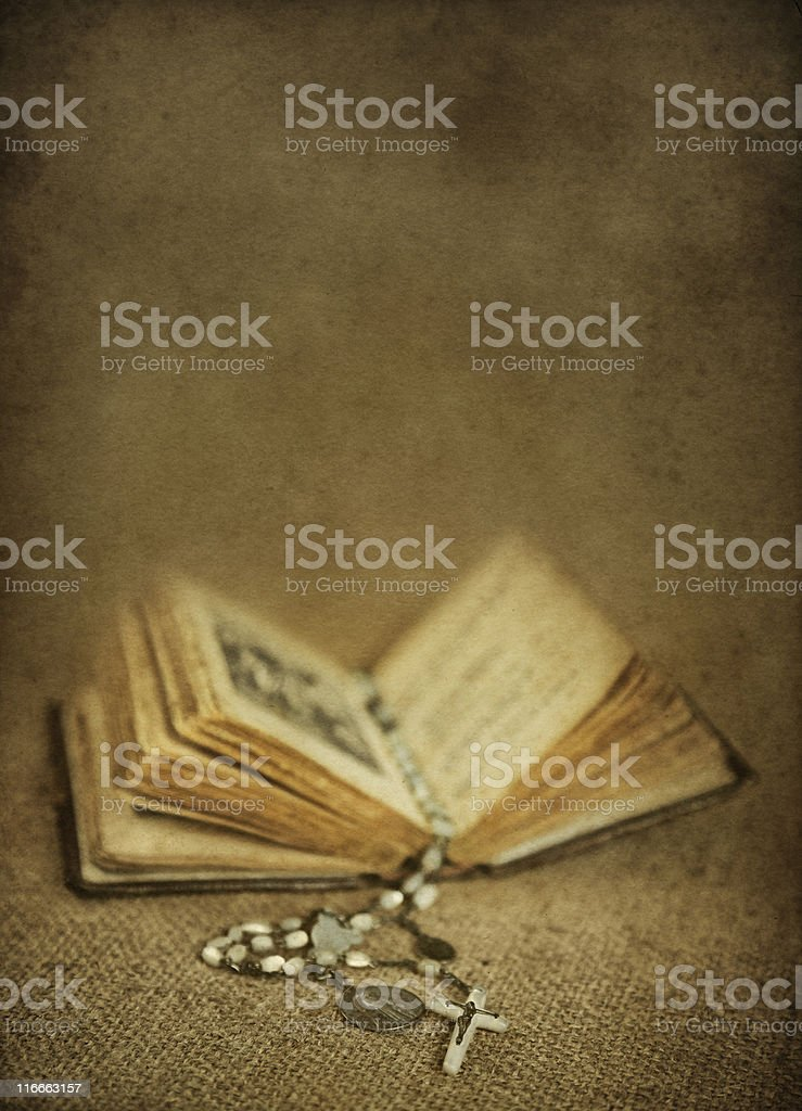old prayer book with rosary stock photo