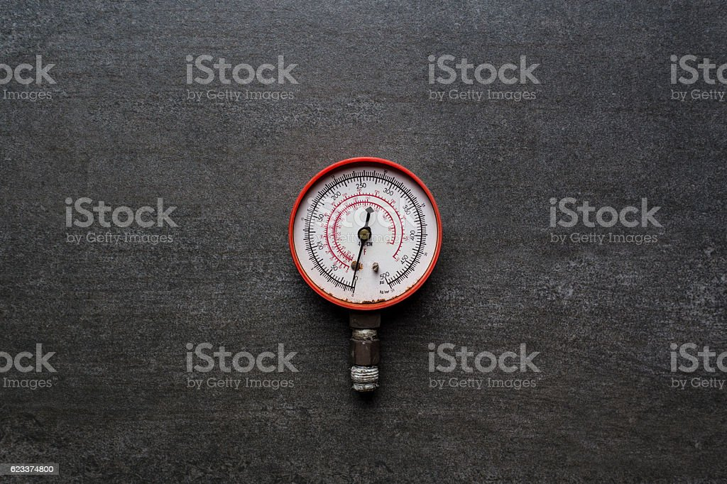 old pressure gauge on black background stock photo