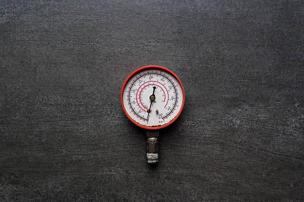 old pressure gauge on black background - barometer bildbanksfoton och bilder