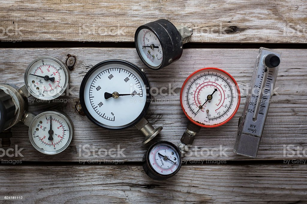 old pressure gauge on wood table background stock photo