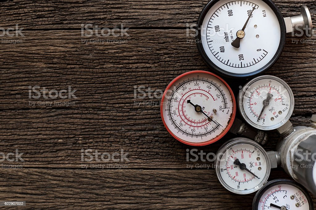 Old pressure gauge on wood table stock photo