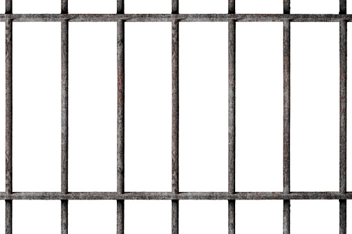 Old prison rusted metal bars cell lock isolated on white background with clipping path