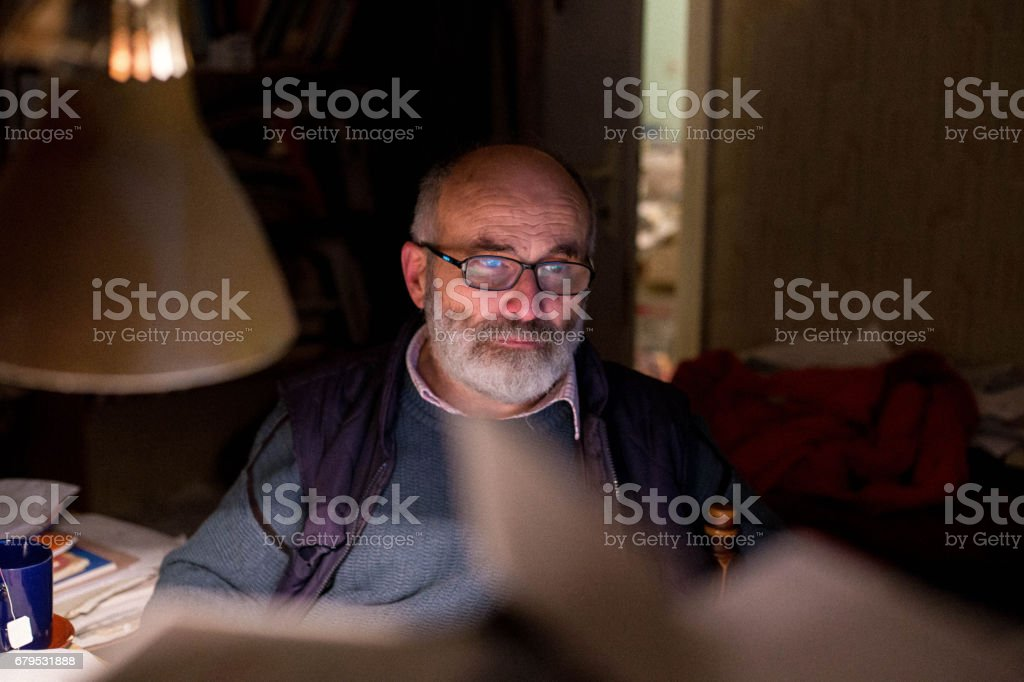 Old professor evaluates students tests royalty-free stock photo