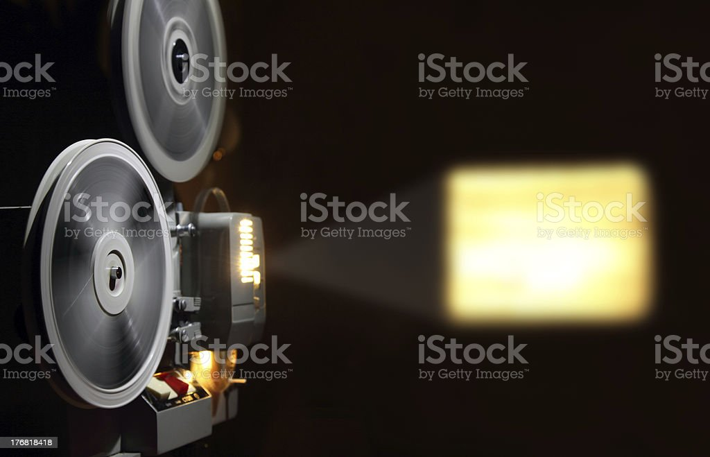 old projector showing film stock photo