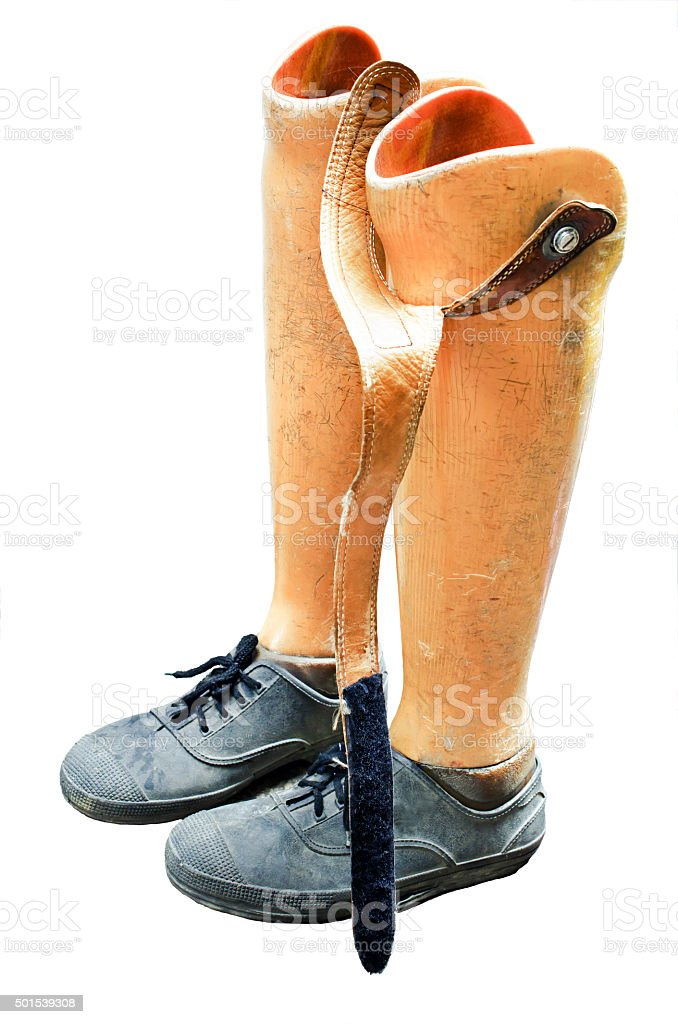 Old prosthetic legs set on white background stock photo